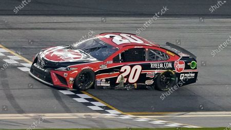 Christopher Bell crosses the finish line to win the NASCAR Cup Series road course auto race at Daytona International Speedway, in Daytona Beach, Fla