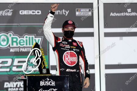Christopher Bell celebrates in Victory Lane after winning the NASCAR Cup Series road course auto race at Daytona International Speedway, in Daytona Beach, Fla