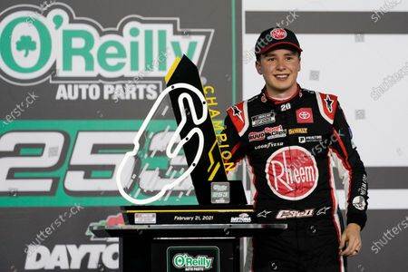 Stock Picture of Christopher Bell celebrates in Victory Lane after winning the NASCAR Cup Series road course auto race at Daytona International Speedway, in Daytona Beach, Fla