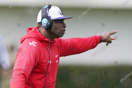 Jackson State football coach Deion Sanders calls out to his players during the first half of an NCAA college football against Edward Waters in Jackson, Miss., . The game marks Sanders's collegiate head coaching debut