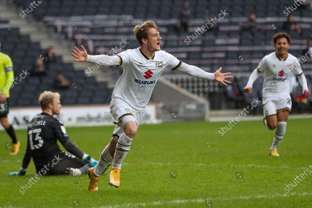 Charlie Brown celebrates after scoring for Milton Keynes Dons, to take the lead making it 4 - 3 against Northampton Town, during the Sky Bet League One match between MK Dons and Northampton Town at Stadium MK