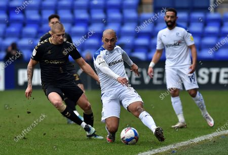 Oldham Athletic's Harry Clarke tussles with James Vaughan of Tranmere Rovers during the Sky Bet League 2 match between Tranmere Rovers and Oldham Athletic at Prenton Park