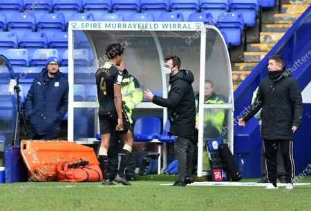 Oldham Athletic's Sido Jombati leaves the field after being sent off during the Sky Bet League 2 match between Tranmere Rovers and Oldham Athletic at Prenton Park