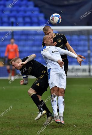 James Vaughan of Tranmere Rovers tussles with Oldham Athletic's Harry Clarke and Oldham Athletic's Nicky Adams during the Sky Bet League 2 match between Tranmere Rovers and Oldham Athletic at Prenton Park