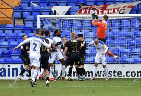 Oldham Athletic's Ian Lawlor (Goalkeeper) under pressure from James Vaughan of Tranmere Rovers during the Sky Bet League 2 match between Tranmere Rovers and Oldham Athletic at Prenton Park