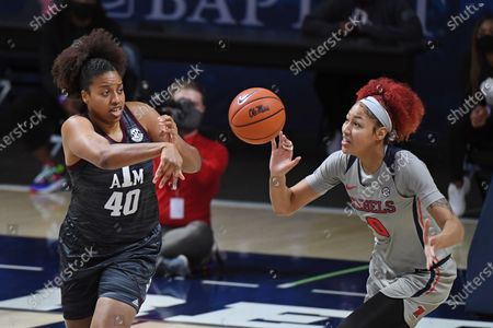 Texas A&M center Ciera Johnson (40) passes the ball past Mississippi forward Shakira Austin (0) during the first half of an NCAA college basketball game in Oxford, Miss