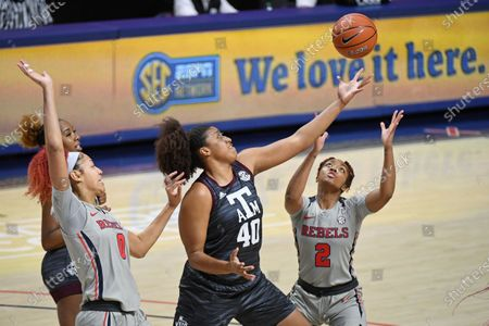 Mississippi forward Shakira Austin (0) and guard Mimi Reid (2) go up for a rebound past Texas A&M center Ciera Johnson (40) during the first half of an NCAA college basketball game in Oxford, Miss