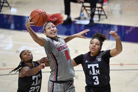 Mississippi forward Shakira Austin (0) goes up for a rebound over Texas A&M guards McKinzie Green (23) and Destiny Pitts (3) during the second half of an NCAA college basketball game in Oxford, Miss., . Texas A&M won 66-55