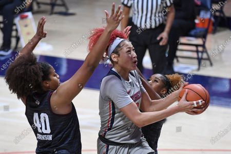 Mississippi forward Shakira Austin (0) goes up for a shot past Texas A&M center Ciera Johnson (40) and guard Kayla Wells (11) during the second half of an NCAA college basketball game in Oxford, Miss., . Texas A&M won 66-55