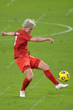 Canada midfielder Sophie Schmidt (13) attempts a shot on goal during the first half of a SheBelieves Cup women's soccer match against Argentina, in Orlando, Fla
