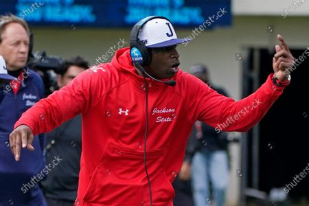 Jackson State football coach Deion Sanders calls out to his players during the first half of an NCAA college football against Edward Waters in Jackson, Miss., . The game marks Sanders inaugural collegiate head coaching debut. Jackson State won 53-0