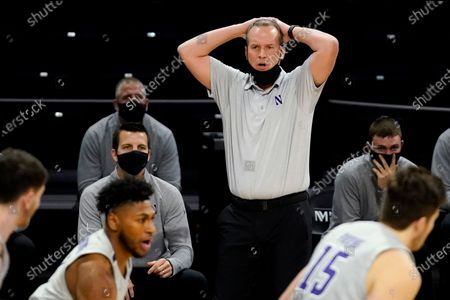 Northwestern head coach Chris Collins reacts as he watches his team during the first half of an NCAA college basketball game against Wisconsin in Evanston, Ill
