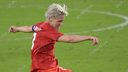 Canada midfielder Sophie Schmidt (13) kicks a ball during the first half of a SheBelieves Cup women's soccer match against Argentina, in Orlando, Fla