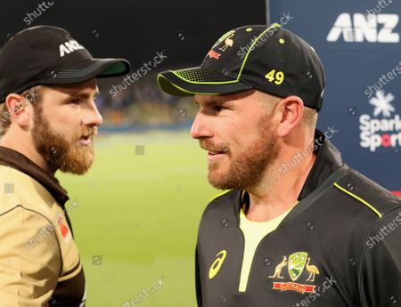 Kane Williamson of New Zealand (L) and Australian captain Aaron Finch (R) after the 1st T20 cricket match between Australia and New Zealand at Hagley Park, Christchurch, New Zealand, 22 February 2021.