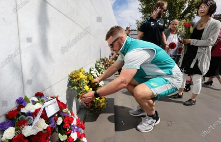 Captain of the Australian T20 cricket team Aaron Finch lays a wreath during a memorial service to mark the 10th anniversary of the Christchurch earthquake in Christchurch, New Zealand 22 February 2021. New Zealand marks the tenth anniversary of the Christchurch earthquake which killed 185 people.