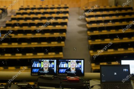 United Nations High Commissioner for Human Rights, Chilean Michelle Bachelet (on screen), delivers her remarks during the opening of the 46th session of the Human Rights Council, at the European headquarters of the United Nations in Geneva, Switzerland, 22 February 2021. Participants are attending the event remotely amid the ongoing coronavirus pandemic.
