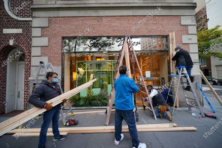 A view of boarded-up luxury stores along Madison Avenue on November 3, 2020 in New York City. After a record-breaking early voting turnout, Americans head to the polls on the last day to cast their vote for incumbent U.S. President Donald Trump or Democratic nominee Joe Biden in the 2020 presidential election.  (Photo by John Nacion/NurPhoto)