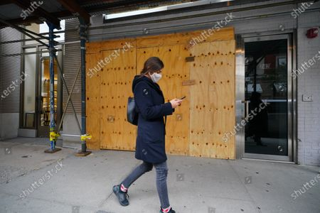 Stock Image of A view of boarded-up luxury stores along Madison Avenue on November 3, 2020 in New York City. After a record-breaking early voting turnout, Americans head to the polls on the last day to cast their vote for incumbent U.S. President Donald Trump or Democratic nominee Joe Biden in the 2020 presidential election.  (Photo by John Nacion/NurPhoto)