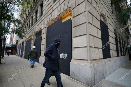 Stock Picture of A view of boarded-up luxury stores along Madison Avenue on November 3, 2020 in New York City. After a record-breaking early voting turnout, Americans head to the polls on the last day to cast their vote for incumbent U.S. President Donald Trump or Democratic nominee Joe Biden in the 2020 presidential election.  (Photo by John Nacion/NurPhoto)