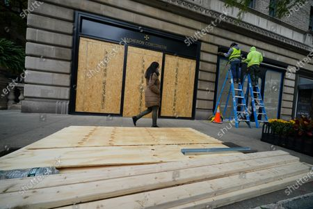 Stock Photo of A view of boarded-up luxury stores along Madison Avenue on November 3, 2020 in New York City. After a record-breaking early voting turnout, Americans head to the polls on the last day to cast their vote for incumbent U.S. President Donald Trump or Democratic nominee Joe Biden in the 2020 presidential election.  (Photo by John Nacion/NurPhoto)