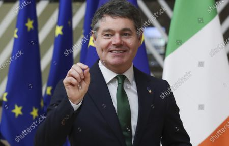 Ireland's Finance Minister Paschal Donohoe speaks with the media as he arrives ahead of a meeting at the European Council building in Brussels