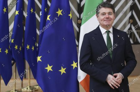 Ireland's Finance Minister Paschal Donohoe poses for a photographer as he arrives ahead of a meeting at the European Council building in Brussels