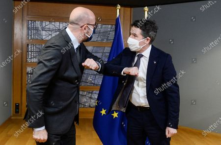 Ireland's Finance Minister and President of the Eurogroup Paschal Donohoe, right, is greeted with an elbow bump by European Council President Charles Michel prior to a meeting at the European Council building in Brussels