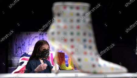 A Bonham's staff member with the DAMIEN HIRST FOR MANOLO BLAHNIK Spin Boots, circa 2002 £ 2,000 - 3,000.  The sale takes place on 25 February in London.