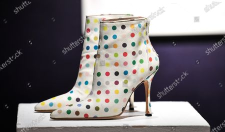 Damien Hirst X Manolo Blahnik Spin/ Spot Boots. Estimate: £2,000 - 3,000 each. The sale takes place on 25 February in London.
