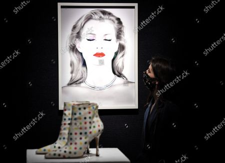 A Bonham's staff member with the Chris Levine (Canadian/British, born 1972), Kate Moss She's Light (Pure), 2014.  Estimate: £20,000 - 30,000 and the Damien Hirst X Manolo Blahnik Spin/ Spot Boots. Estimate: £2,000 - 3,000 each. The sale takes place on 25 February in London.