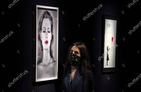 A Bonham's staff member with the Chris Levine (Canadian/British, born 1972), Kate Moss She's Light (Pure), artwork, 2014.  Estimate: £20,000 - 30,000 and the Banksy, Girl with Balloon. Estimate: £100,000-150,000. The sale takes place on 25 February in London.