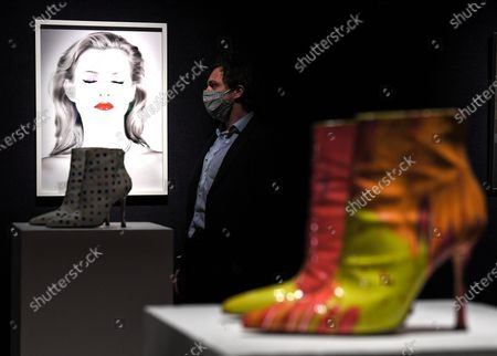 Stock Image of A Bonham's staff member with the Chris Levine (Canadian/British, born 1972), Kate Moss She's Light (Pure), artwork, 2014.  Estimate: £20,000 - 30,000 and the DAMIEN HIRST FOR MANOLO BLAHNIK Spin Boots, circa 2002£ 2,000 - 3,000. The sale takes place on 25 February in London.