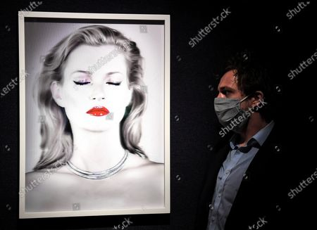 A Bonham's staff member with the Chris Levine (Canadian/British, born 1972), Kate Moss She's Light (Pure), artwork, 2014.  Estimate: £20,000 - 30,000.  The sale takes place on 25 February in London.