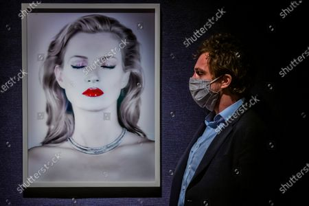 A photographic artwork of supermodel Kate Moss by Chris Levine - jointly donated by them to raise funds for Oxfam GB it has an estimate of £20,000 - 30,000. Preview of Bonhams' British. Cool. sale which is a cross-departmental sale of works of art, photographs, designer fashion and entertainment memorabilia which showcases a diverse range of British and émigré talent from the last one hundred years. The sale takes place sale on 25 February at New Bond Street.
