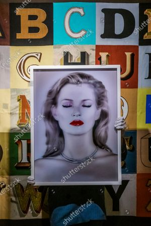 A photographic artwork of supermodel Kate Moss by Chris Levine - jointly donated by them to raise funds for Oxfam GB it has an estimate of £20,000 - 30,000 in front of Peter Blakes Alphabet - Preview of Bonhams' British. Cool. sale which is a cross-departmental sale of works of art, photographs, designer fashion and entertainment memorabilia which showcases a diverse range of British and émigré talent from the last one hundred years. The sale takes place sale on 25 February at New Bond Street.