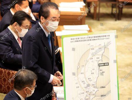 Former Japanese Prime Minister and an opposition lawmaker Naoto Kan questions to Prime Minister Yoshihide Suga at Lower House's budget committee session at the National Diet in Tokyo on Monday, February 22, 2021.