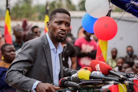 "Stock Image of Ugandan opposition figure Bobi Wine, whose real name is Kyagulanyi Ssentamu, speaks at a press conference in Kampala, Uganda . Wine says he will withdraw a legal petition that sought to overturn the victory of President Yoweri Museveni in last month's presidential election, charging that Uganda's courts are filled with ""yes-men"" appointed by Museveni and that he did not expect a fair decision from the panel of nine judges"