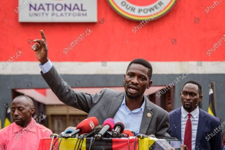 "Stock Picture of Ugandan opposition figure Bobi Wine, whose real name is Kyagulanyi Ssentamu, speaks at a press conference in Kampala, Uganda . Wine says he will withdraw a legal petition that sought to overturn the victory of President Yoweri Museveni in last month's presidential election, charging that Uganda's courts are filled with ""yes-men"" appointed by Museveni and that he did not expect a fair decision from the panel of nine judges"