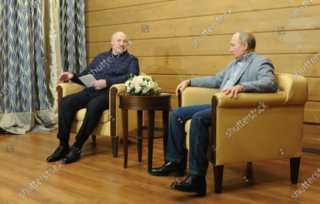 Russian President Vladimir Putin (R) and Belarus President Alexander Lukashenko (L) talk during their meeting in the Black sea resort of Sochi, Russia, 22 February 2021.