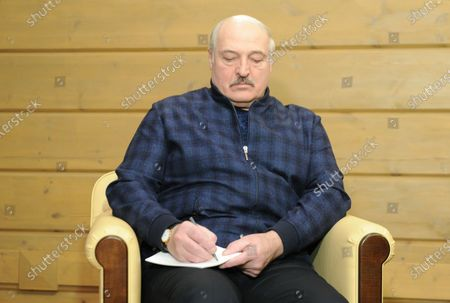 Belarus President Alexander Lukashenko talks with Russian President Vladimir Putin (not pictured) during their meeting in the Black sea resort of Sochi, Russia, 22 February 2021.