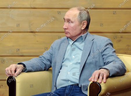 Russian President Vladimir Putin talks with Belarus President Alexander Lukashenko (not pictured) during their meeting in the Black sea resort of Sochi, Russia, 22 February 2021.