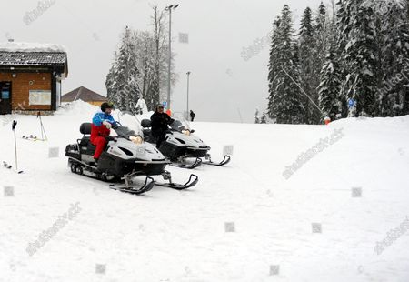 Russian President Vladimir Putin (L) and Belarus President Alexander Lukashenko (R) ride snowmobiles during their meeting in the Black Sea resort of Sochi, Russia, 22 February 2021.