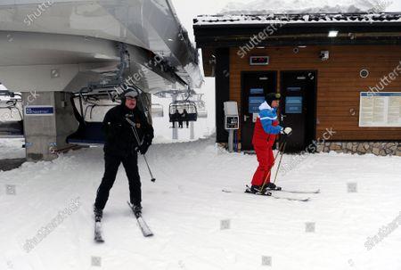 Russian President Vladimir Putin (R) and Belarus President Alexander Lukashenko (L) ski during their meeting in the Black Sea resort of Sochi, Russia, 22 February 2021.