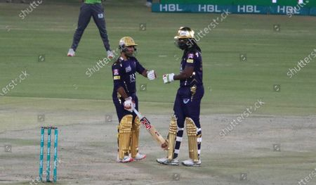 Quetta Gladiator's Chris Gayle (R) celebrates with team-mate Sarfaraz Ahmed during the Pakistan Super League (PSL) T20 cricket match between the Lahore Qalandars and Quetta Gladiator's at the National Stadium in Karachi, Pakistan, 22 February 2021.