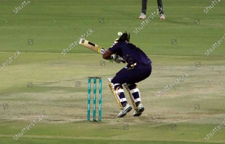 Quetta Gladiator's Chris Gayle plays a shot during the Pakistan Super League (PSL) T20 cricket match between the Lahore Qalandars and Quetta Gladiator's at the National Stadium in Karachi, Pakistan, 22 February 2021.
