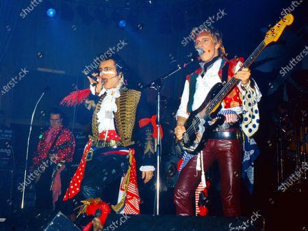 Stock Image of Adam and The Ants performing in Birmingham circa 1984: left Marco Pirroni, Adam Ant, Gary Tibbs