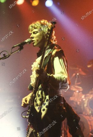 Stock Picture of Adam and The Ants performing in Birmingham circa 1984: Gary Tibbs