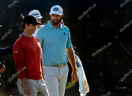 Dustin Johnson, right, walks off the 16th green with Adam Scott during the second round of the Genesis Invitational on February 19, 2021 in Pacific Palisades, California. Johnson is tied for second place at 7-under par. Scott made the cut at even par.(Gina Ferazzi / Los Angeles Times)