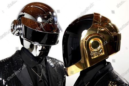 Thomas Bangalter, left, and Guy-Manuel de Homem-Christo, from the music group, Daft Punk, pose for a portrait in Los Angeles. The Grammy-winning French act have announced their break up