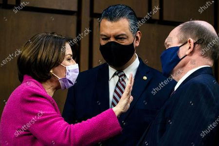 Sen. Amy Klobuchar, D-Minn., speaks with Sen. Alex Padilla, D-Calif., and Sen. Chris Coons, D-Del., right, during a break Attorney General nominee Merrick Garland's confirmation hearing before the Senate Judiciary Committee, on Capitol Hill in Washington